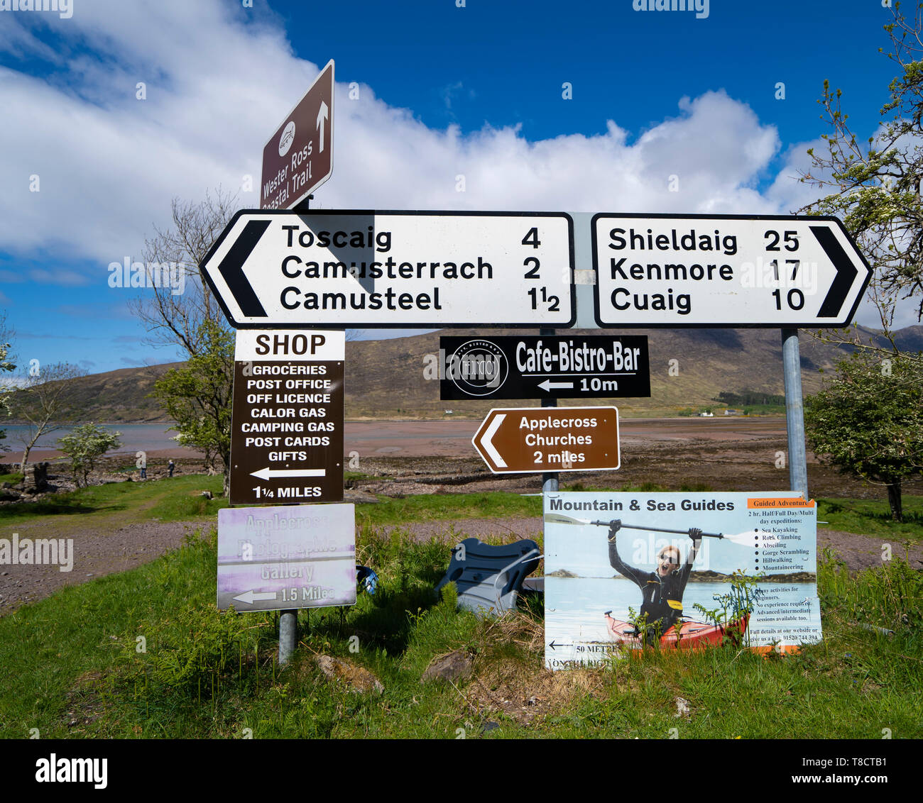 Road signs at Applecross on the North Coast 500 scenic driving route in northern Scotland, UK - Stock Image