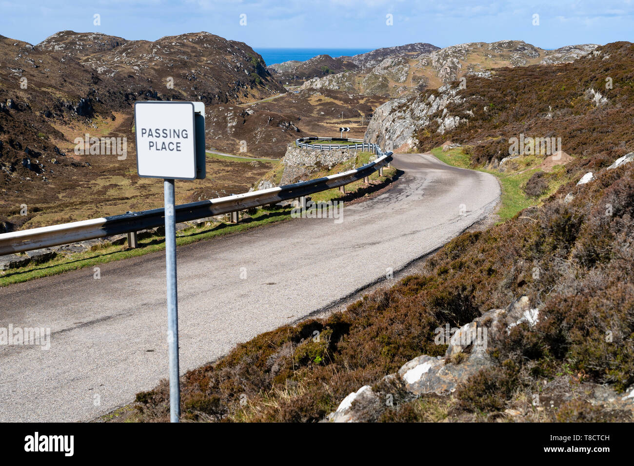 Single track road and passing place on the North Coast 500 scenic driving route in Assynt northern Scotland, UK - Stock Image