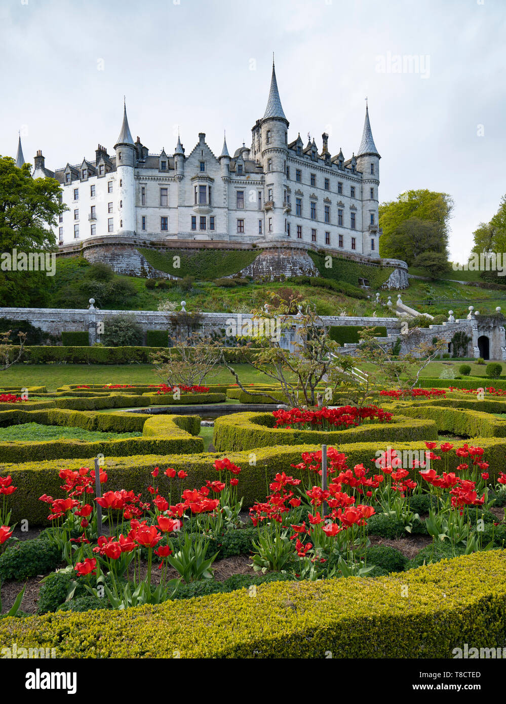 View of Dunrobin Castle and gardens on the North Coast 500 scenic driving route in northern Scotland, UK - Stock Image