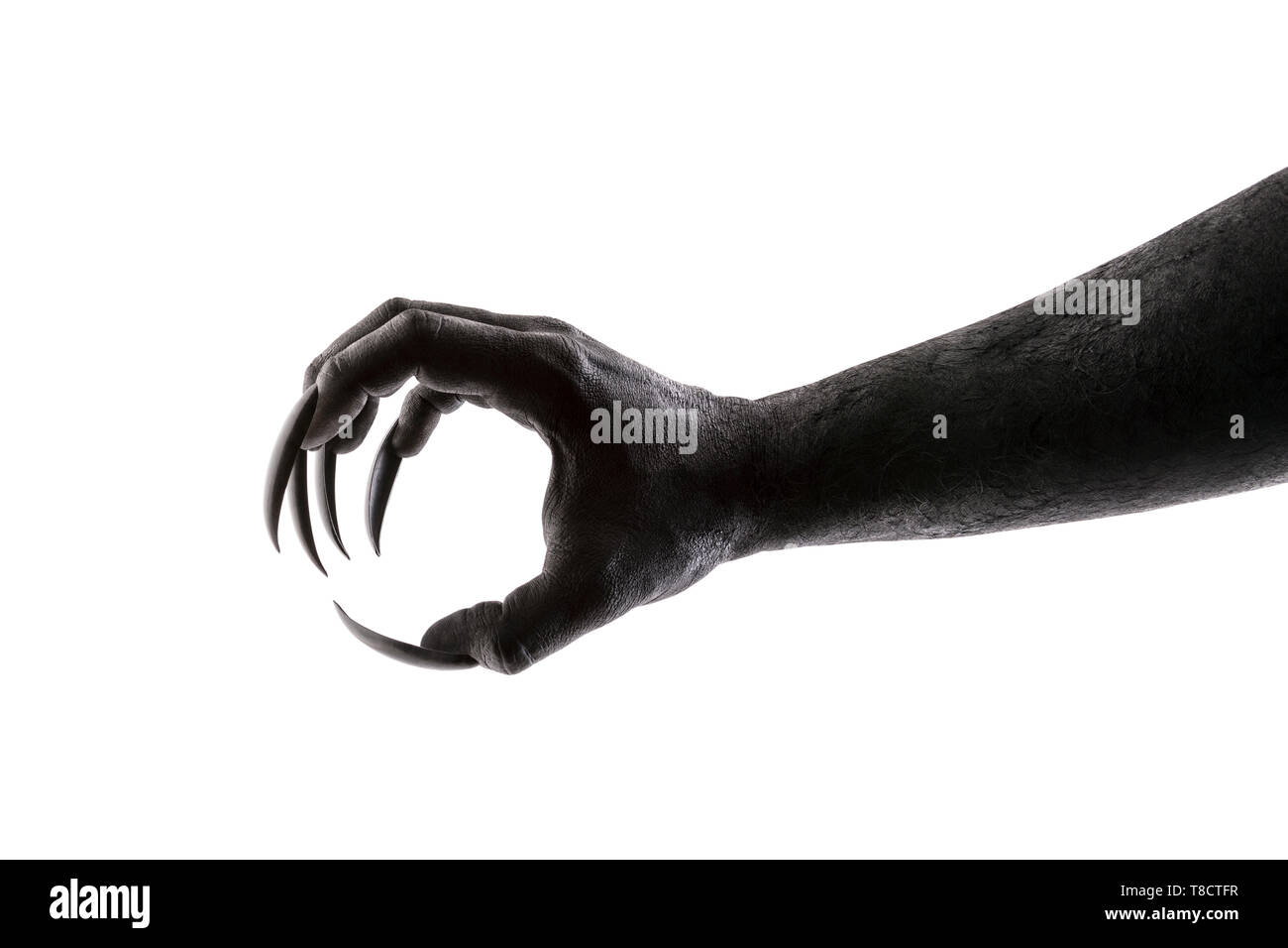 Creepy monster claw isolated on white background with clipping path - Stock Image