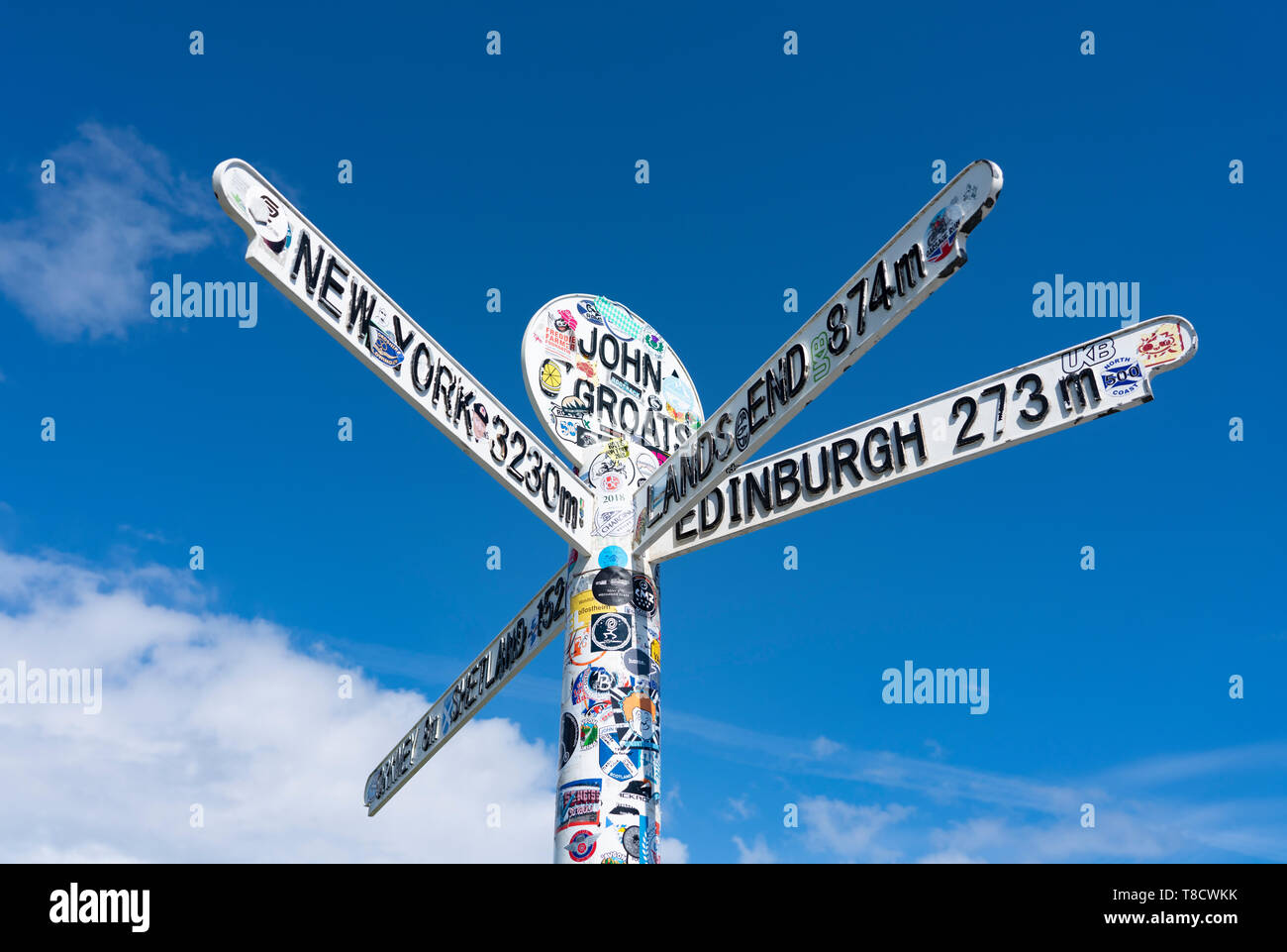 Signpost with distances at John O' Groats on  the North Coast 500 scenic driving route in northern Scotland, UK - Stock Image