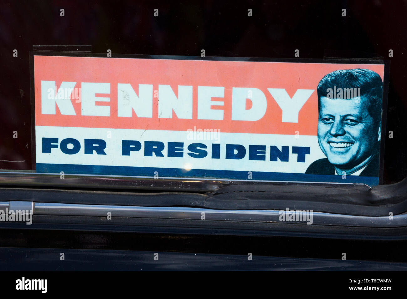 Period vote for kennedy john f kennedy to be us president for president of the usa window sticker in a vintage car as a rally in the uk