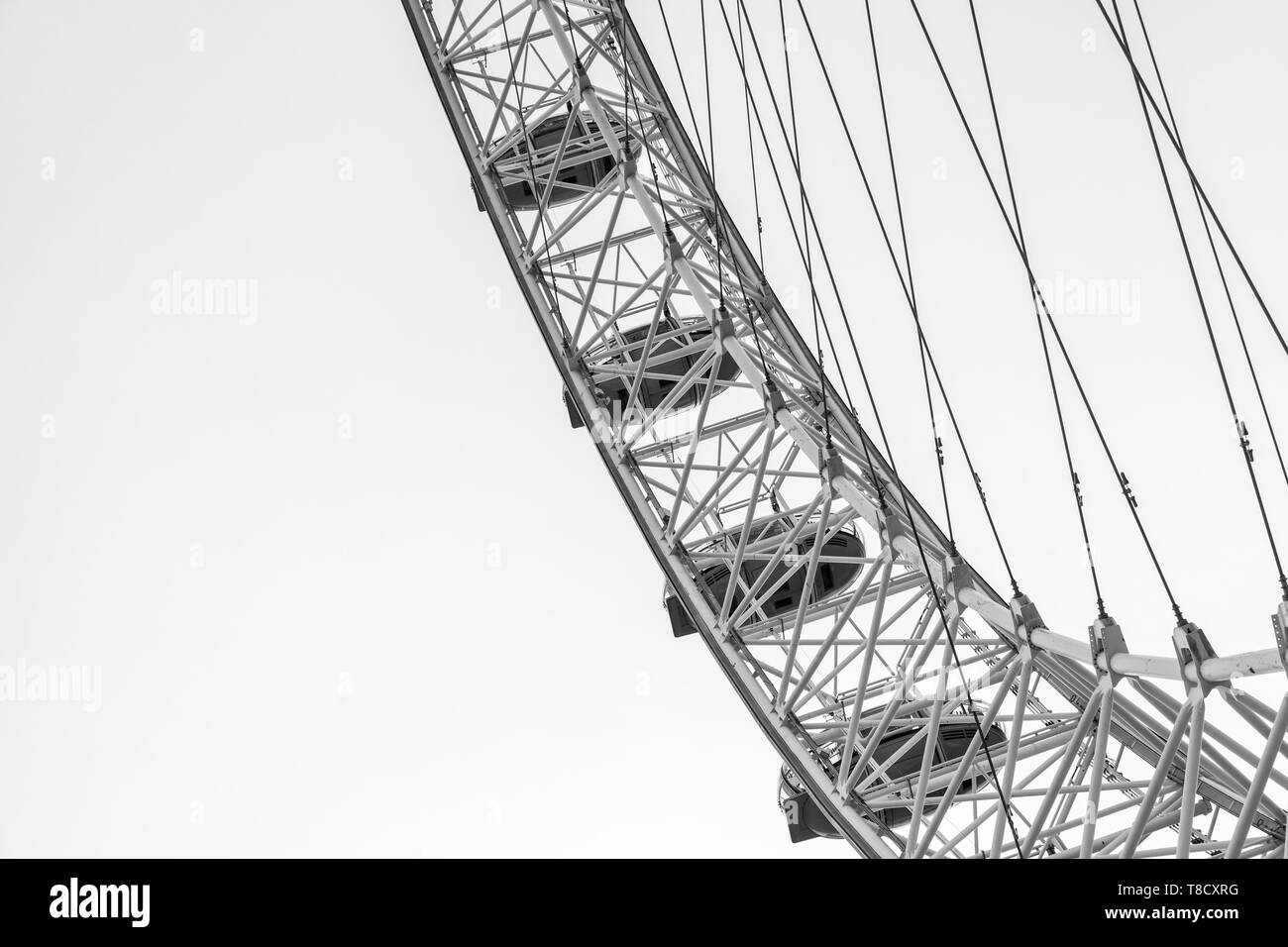 London, United Kingdom - October 31, 2017: Fragment of London Eye giant Ferris wheel mounted on the South Bank of River Thames in London, black and wh - Stock Image