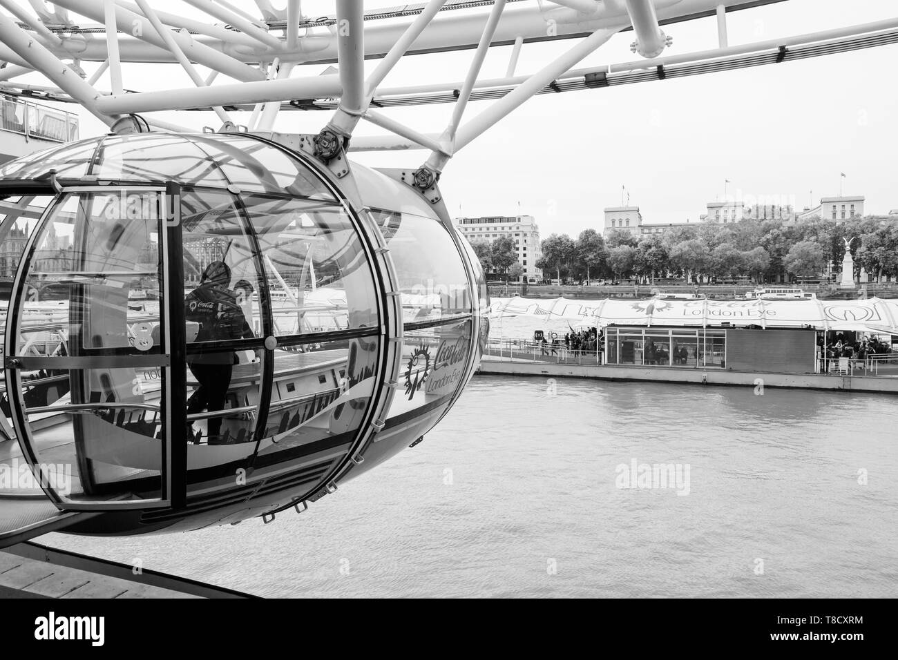 London, United Kingdom - October 31, 2017: People are in cabin of London Eye giant Ferris wheel mounted on the South Bank of River Thames in London, b - Stock Image
