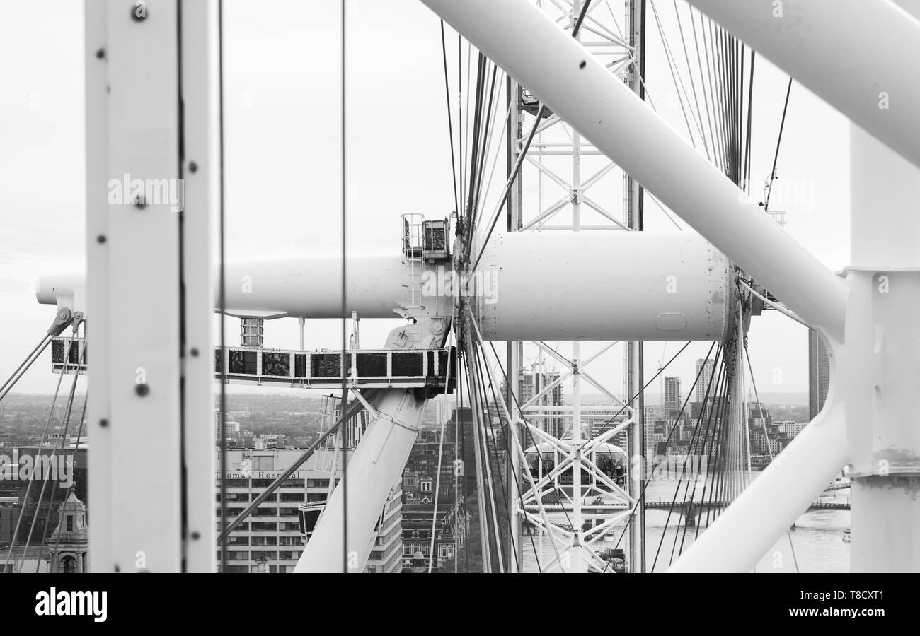 London, United Kingdom - October 31, 2017: Axis of London Eye giant Ferris wheel mounted on the South Bank of River Thames in London, black and white  - Stock Image