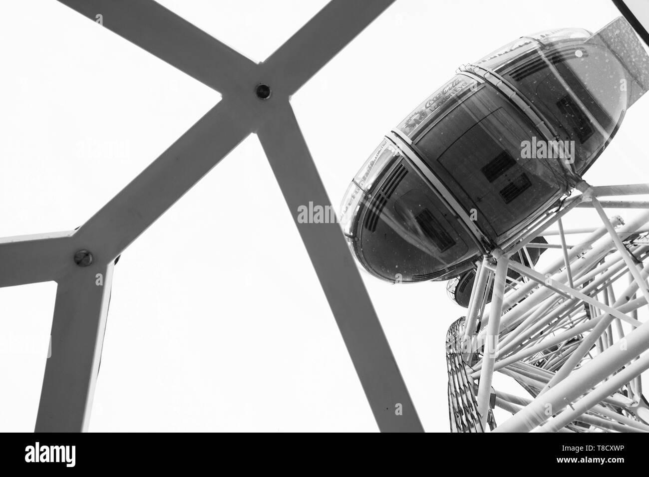 London, United Kingdom - October 31, 2017: Cabin of London Eye giant Ferris wheel mounted on the South Bank of River Thames in London, black and white - Stock Image