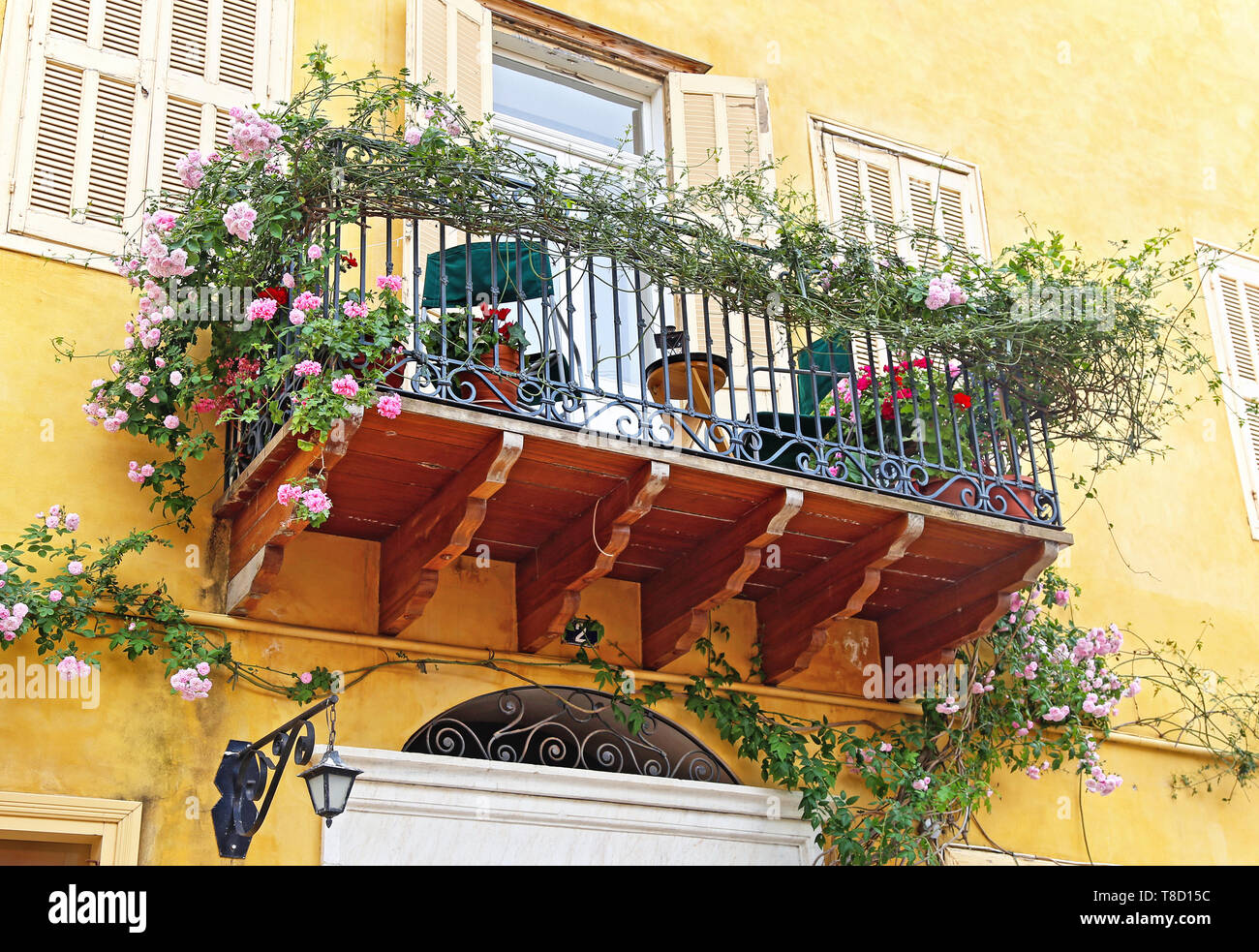 traditional balcony full of flowers in Nafplio Argolis Greece - Stock Image