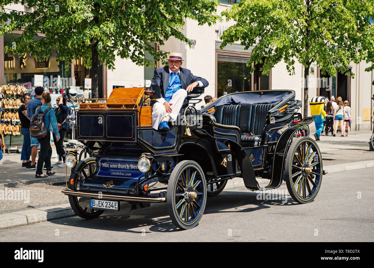 Berlin, Germany - May 31, 2017: man sitting in vintage car parked in city street road. Retro transport concept. Travelling and lifestyle - Stock Image