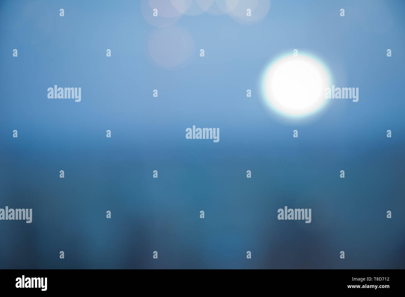 Colorful bokeh background in blurry blue sky background . blue bokeh abstract glow light backgrounds . Defocused blue background with bokeh lights . - Stock Image