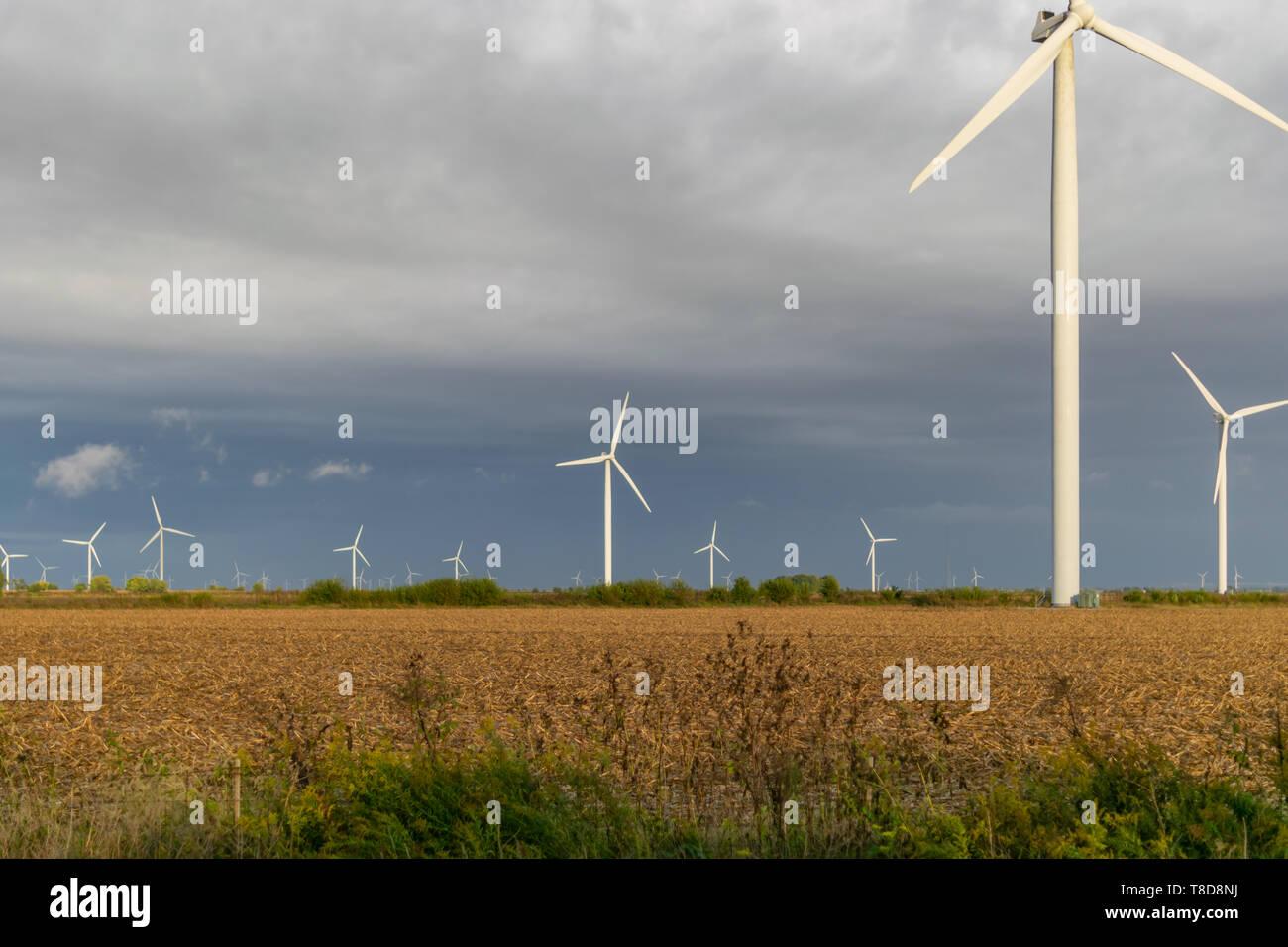 Close up of Wind Turbine farm in an open field. - Stock Image