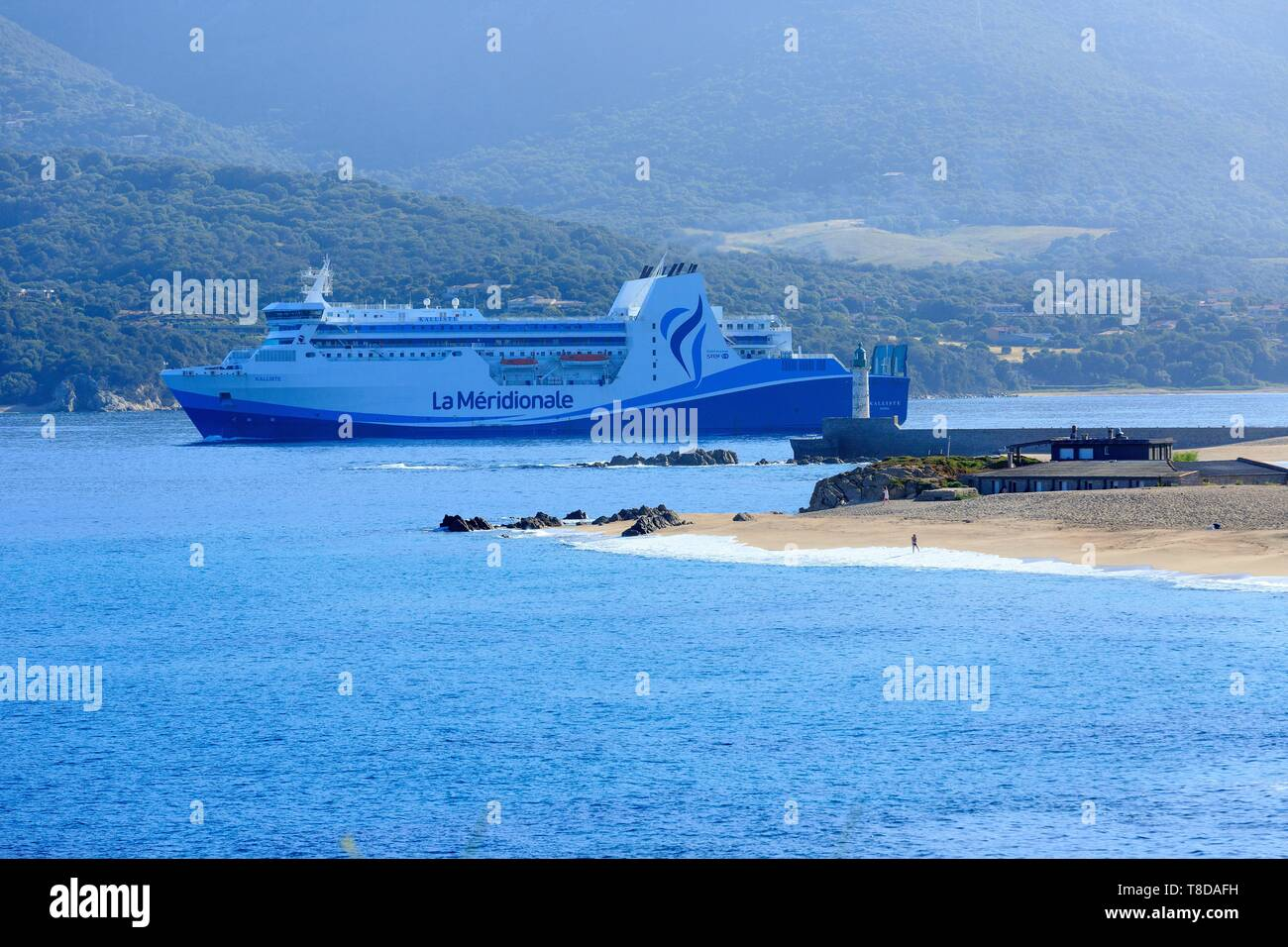 France, Corse du Sud, Propriano, Lido beach and the lighthouse in the background, La Meridionale ferry departure Stock Photo