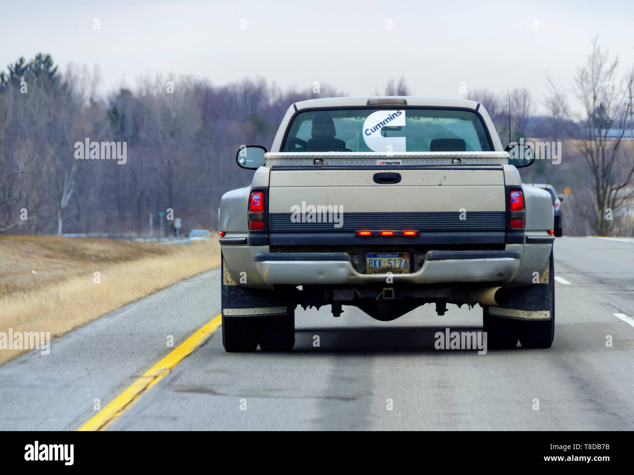 A GMC pickup truck, a gas guzzler, on a highway. - Stock Image