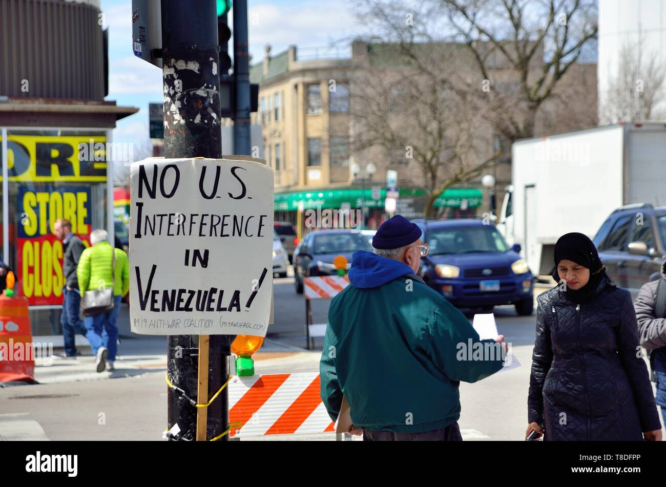Chicago, Illinois, USA. Protesting in the city's Albany Park neighborhood as people post signs and pass out literature for a cause. - Stock Image
