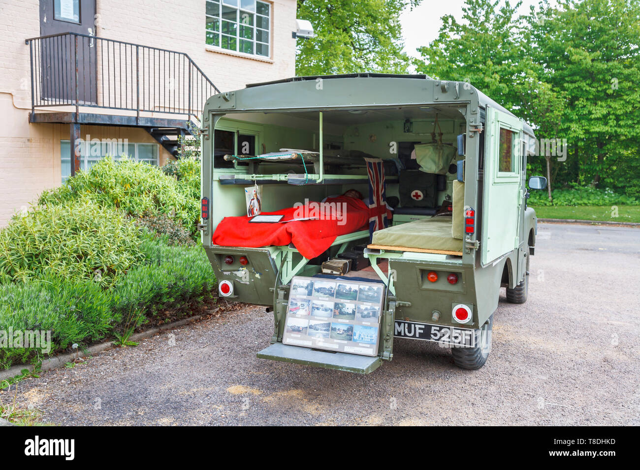 Vintage ambulance outside the Science & Innovation Centre at Bletchley Park, top-secret home of the World War Two Codebreakers, now a heritage museum - Stock Image