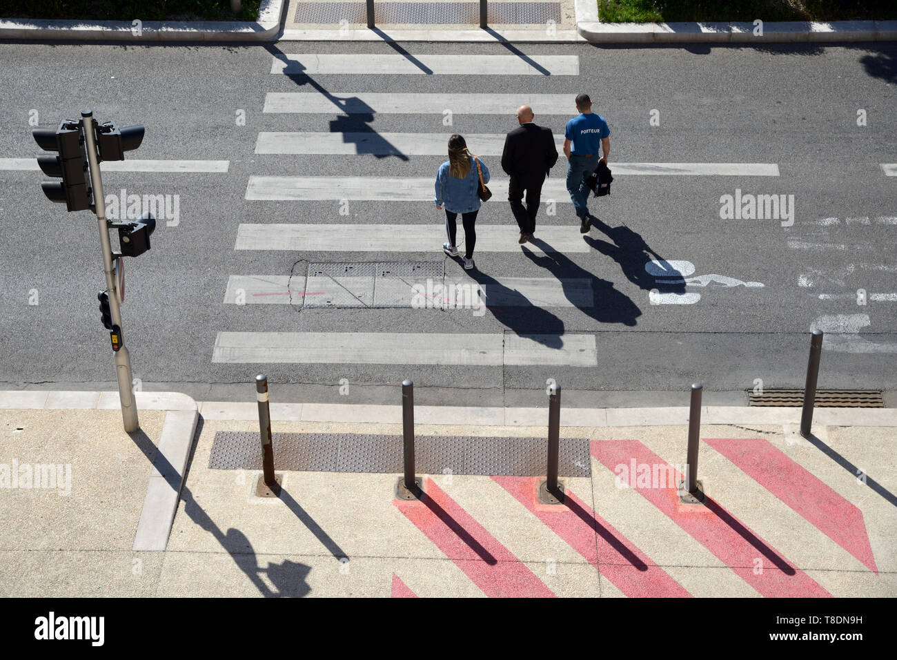High Angle View of Three People or Pedestrians Crossing Pedestrian Crossing or Zebra Marseille France Stock Photo