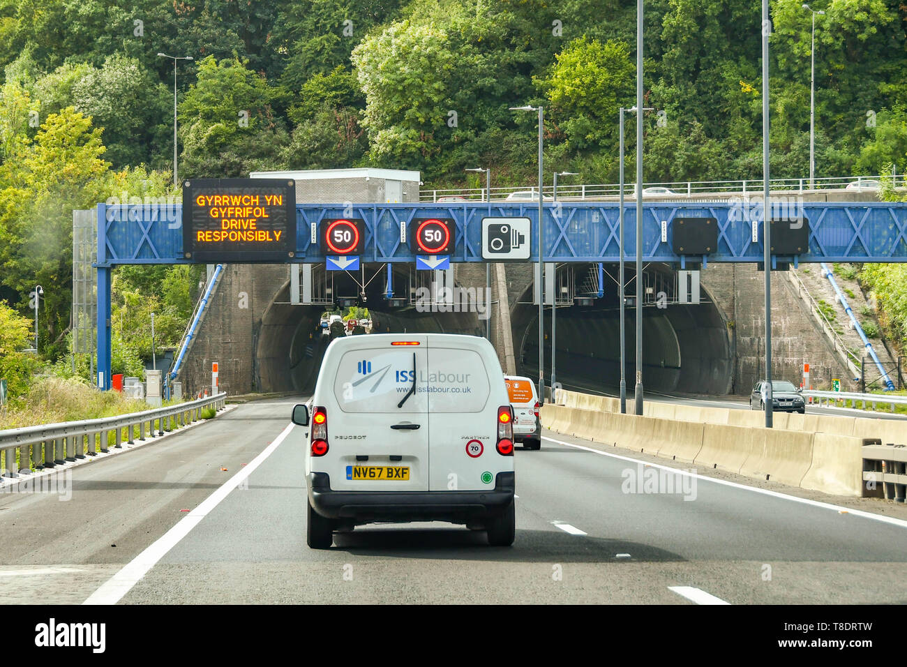 NEWPORT, WALES - SEPTEMBER 2018: White van on the M4 motorway about to enter the Brynglas Tunnels at Newport. The tunnels are a major bottleneck. A de - Stock Image