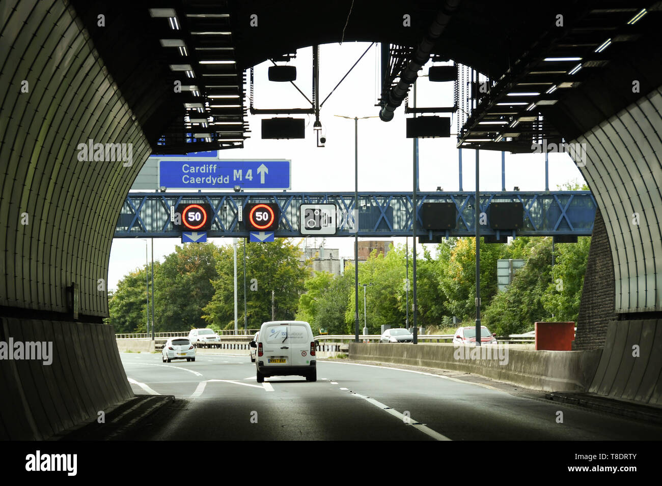 NEWPORT, WALES - SEPTEMBER 2018: White van on the M4 motorway about to exit the Brynglas Tunnels at Newport. The tunnels are a major bottleneck. A dec - Stock Image