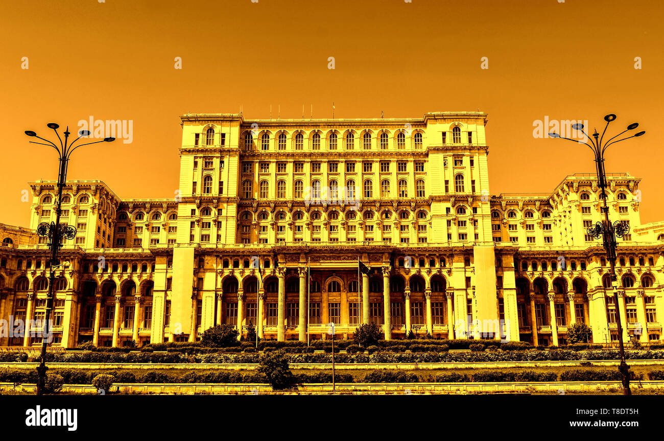 The Palace of the Parliament or People's House, Bucharest, Romania. Night view from the Central Square.  The Palace was ordered by Nicolae Ceaușescu. Stock Photo