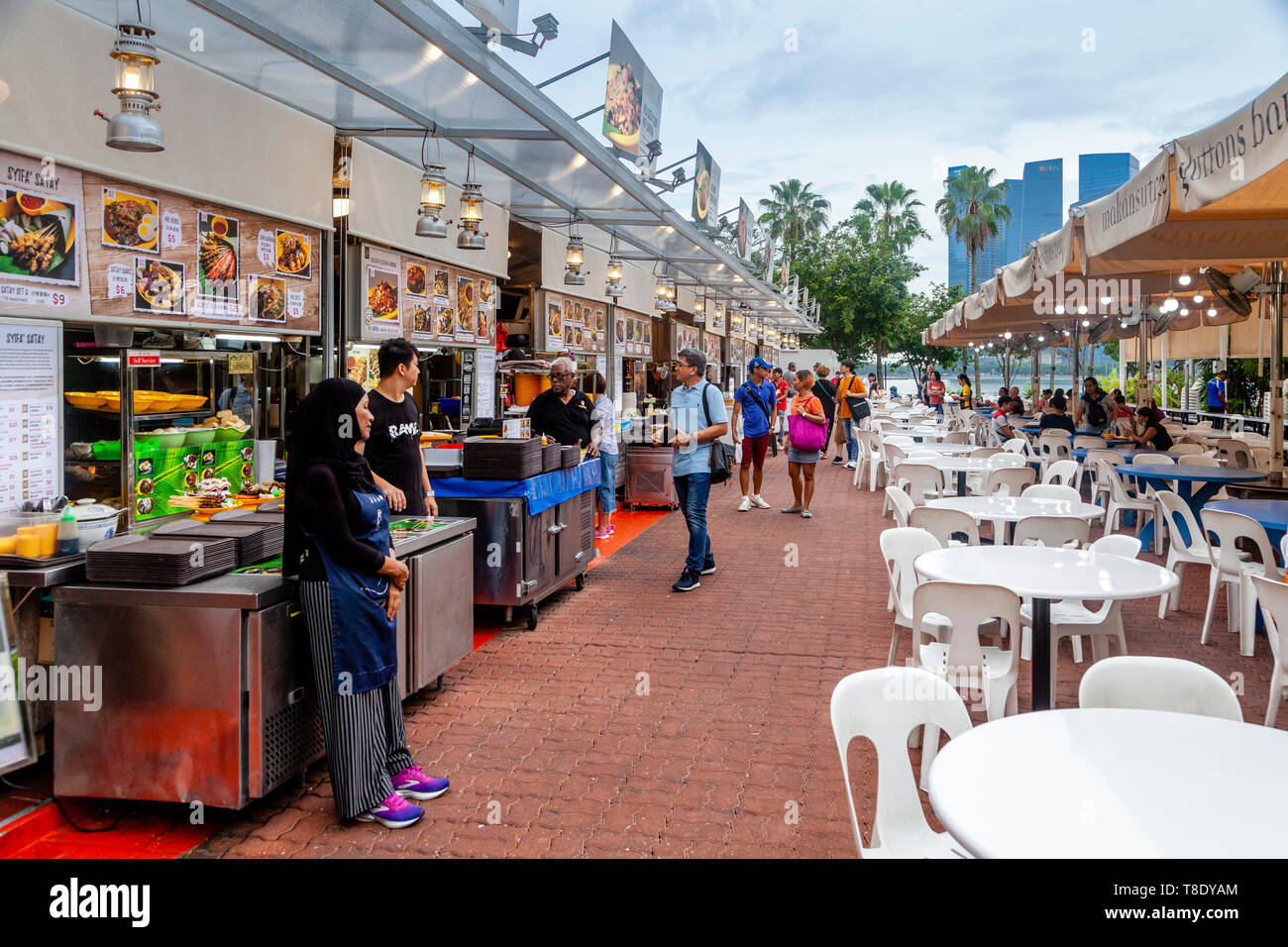 Tourists At An Outside Food Court Near Raffles Avenue, Singapore, South East Asia - Stock Image