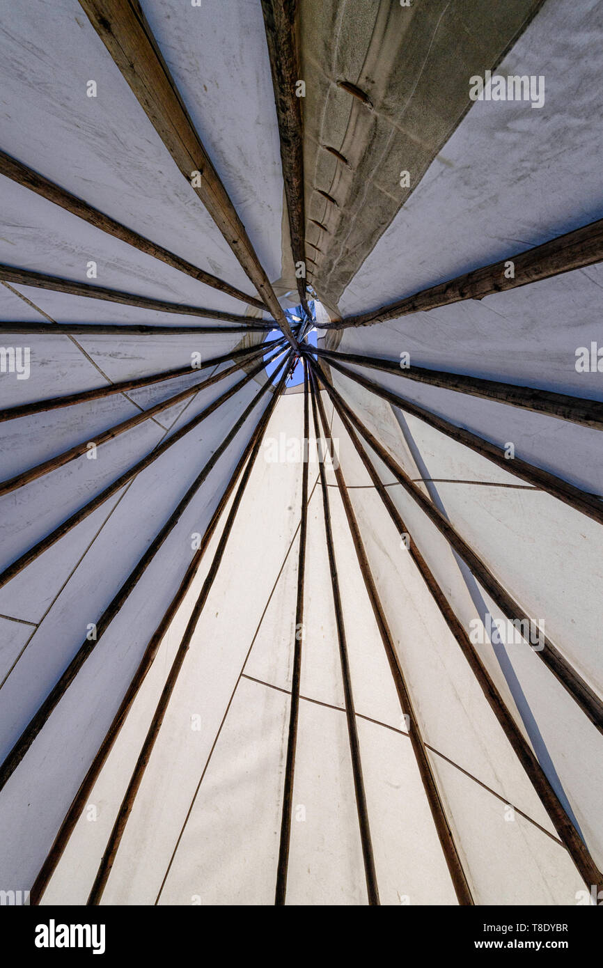 First Nations teepee or tipi, looking up from the interior - Stock Image