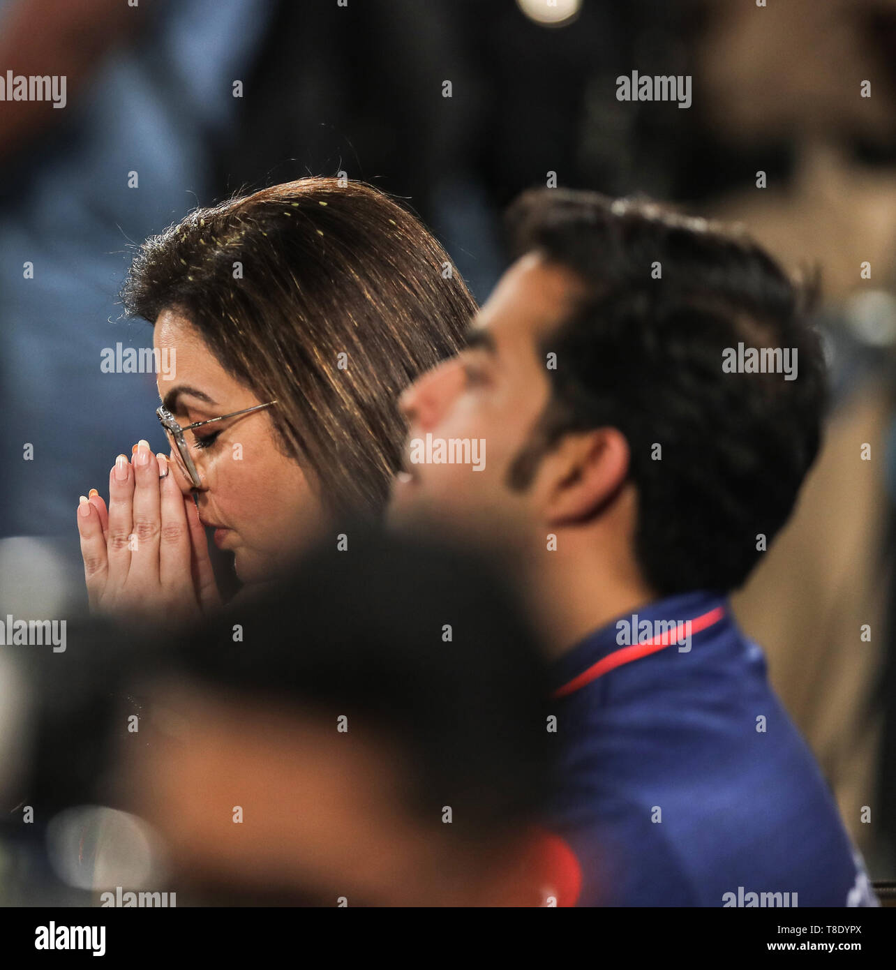 Hyderabad, India, 12th May 2019: IPL 2019 Final Match  : Mumbai Indian's Owner Nita Ambani praying for the victory during Final  Match of IPL in Hyder - Stock Image