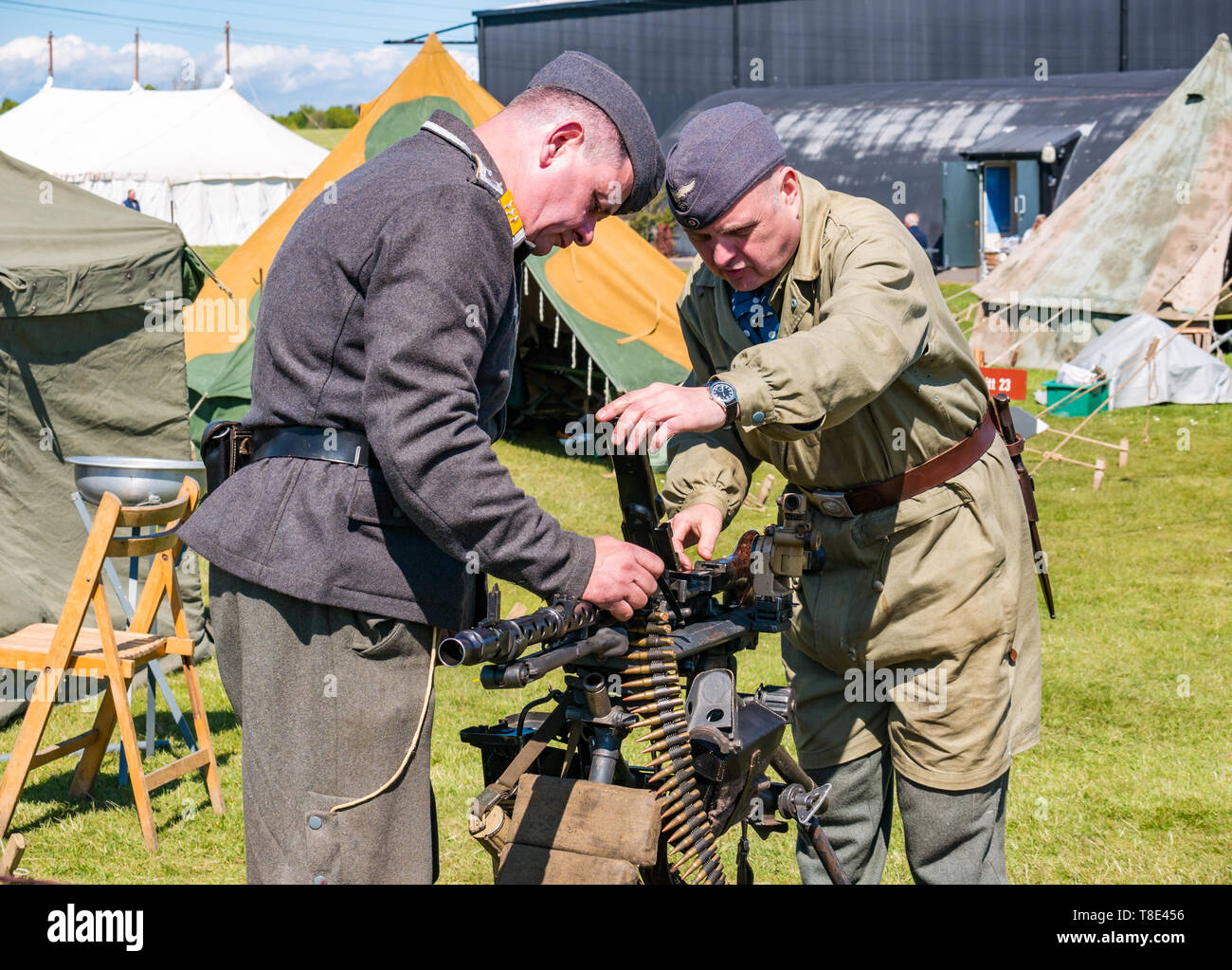 Museum of Flight, East Fortune, East Lothian, Scotland, UK 12th May, 2019. Wartime Experience: A family day out with all things related to the World Wars including a replica of a second world war German army  camp and military equipment,. Men dressed in German military uniform with a machine gun - Stock Image