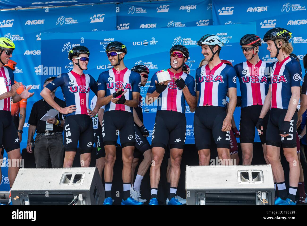 Sacramento, California, USA. 12th May, 2019. TRAVIS MCCABE takes a bite of his birthday cake as Team USA is introduced prior to Stage 1 of the 2019 Amgen Tour of California at California's State Capitol city of Sacramento on Sunday afternoon. Stage 1 begins and ends in Sacramento, where the American and Sacramento Rivers meet before heading west. This is the race's 10th year in Sacramento.The 2019 Amgen Tour of California race will showcase scenic California roadways, coastlines and iconic settings, with more than 750 miles of racing throughout the seven-day event. The race will run north t - Stock Image