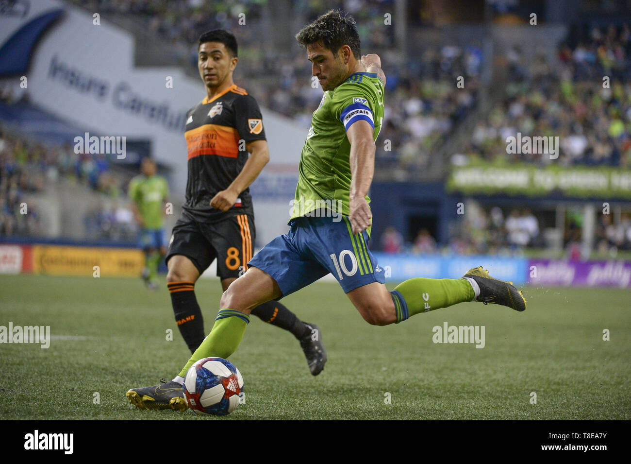 Seattle, Washington, USA. 11th May, 2019. Seattle forward Nico Lodeiro (10) takes a shot as the Houston Dynamo visits the Seattle Sounders in a MLS match at Century Link Field in Seattle, WA. Credit: Jeff Halstead/ZUMA Wire/Alamy Live News - Stock Image