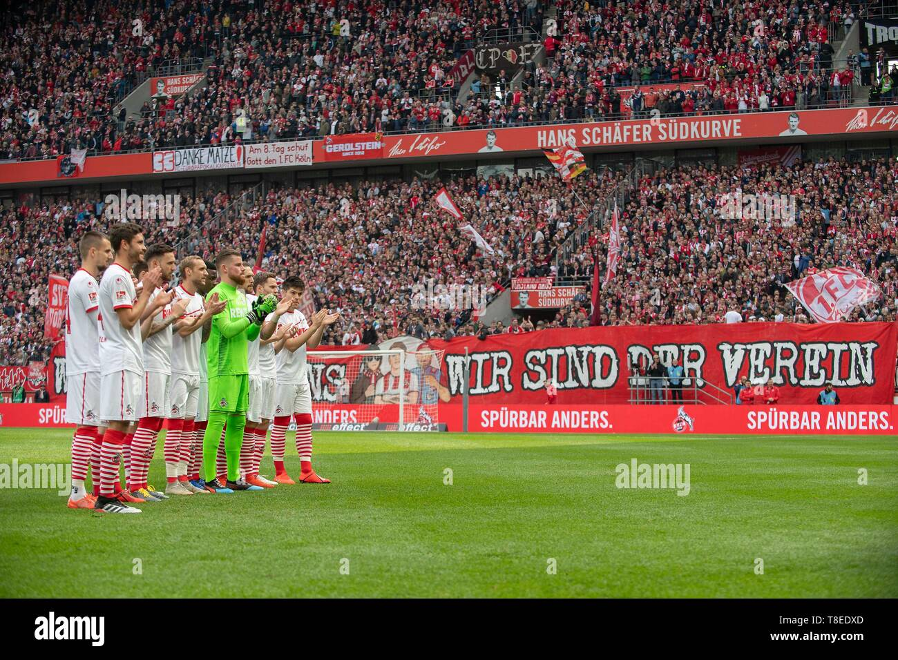 Feature, the team of K applauds Matthias LEHMANN (K) which is adopted, behind it Fankurve of K with a banner 'We are the club'. Soccer 2. Bundesliga, 33. matchday, FC Cologne (K) - Jahn Regensburg (R), on 12.05.2019 in Koeln/Germany. ## DFL regulations prohibit any use of photographs as image sequences and/or quasi-video ## ¬ | usage worldwide - Stock Image