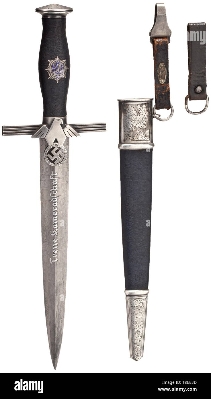 "An honour dagger with Damascus blade for RLB leaders Damascus blade with reverse motto ""Treue Kameradschaft"" in raised etching, obverse maker's logo of Weyersberg, Solingen and name in raised etching. Nickel silver grip fittings, the pommel with etched oak leaves, the cross-guard with an RLB national eagle in relief, the reverse with an etched owner's monogram ""CE"" framed by oak leaves. Blue leathered grip with filigreed RLB emblem (minimal enamel chip). The blue leather-covered steel scabbard with silver-plated fittings, the front with an etched oak leaf décor. Short blue , Editorial-Use-Only Stock Photo"