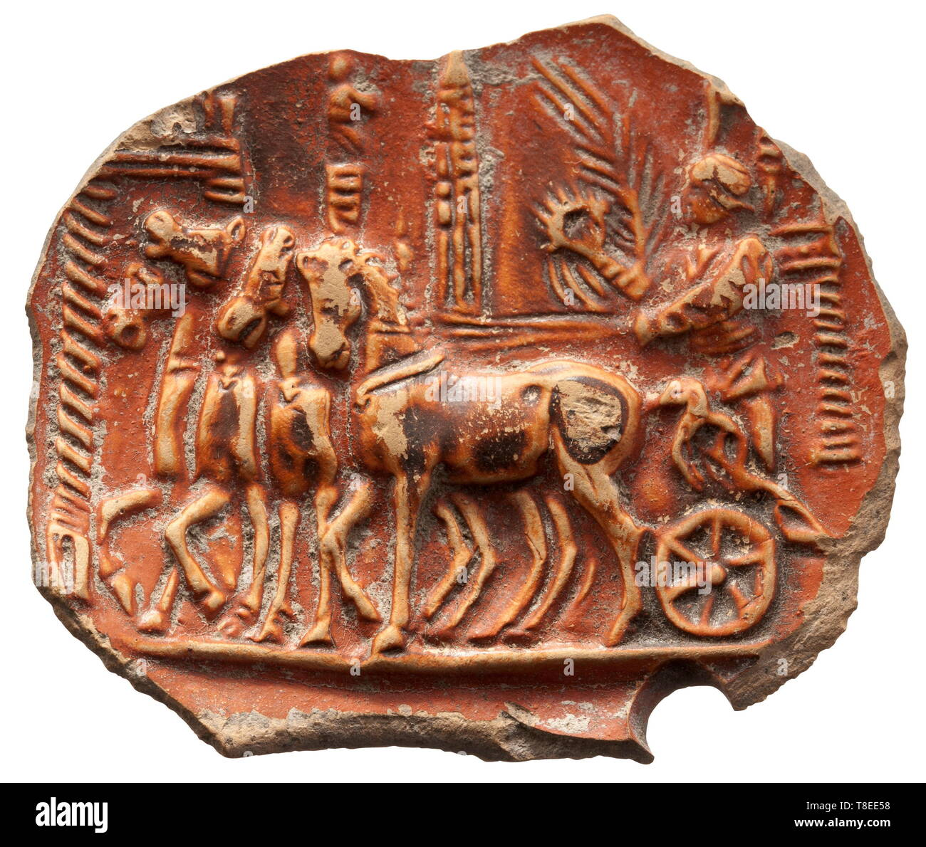 A Roman fragment of an oil lamp with charioteers in the Circus Maximus 1st/2nd century AD. Reddish glazed clay. Finely detailed scene of a victorious charioteer against the background of the Circus Maximus. Width 5.9 cm. Provenance: South German private collection, 1970s and later. historic, historical, Roman Empire, ancient world, ancient times, ancient world, Additional-Rights-Clearance-Info-Not-Available - Stock Image