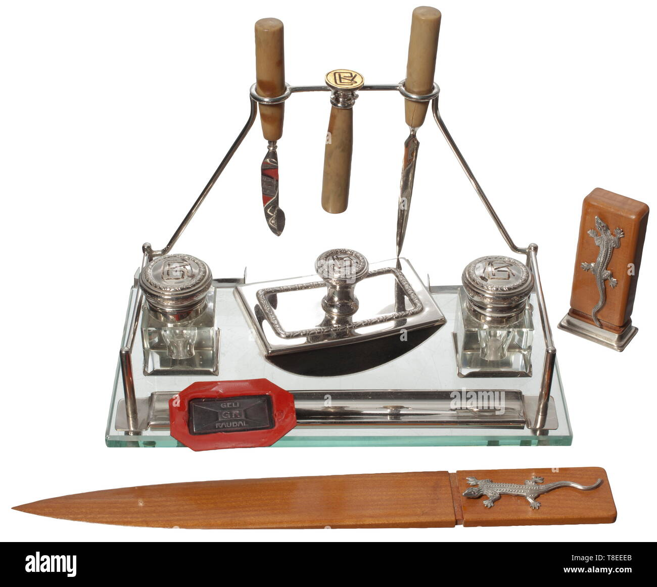 Angela 'Geli' Maria Raubal (1908 - 1931) - a silver-plated lady's writing set Glass, silver-plated metal, consisting of two ink wells, a blotter, a seal with the monogram 'GR', pen knife and letter opener, the ink wells and blotter also with the engraved monogram 'GR'. Another seal with silver seal matrix in the form of an envelope, monogram 'GR' and the name 'Geli Raubal', the wooden grip with applied silver lizard, with an associated letter opener. Size of the set 16 x 19 x 10 cm, height of the lizard seal 7.2 cm. Length of the lizard letter opener 24 cm. Angela 'Geli' Ra, Editorial-Use-Only - Stock Image