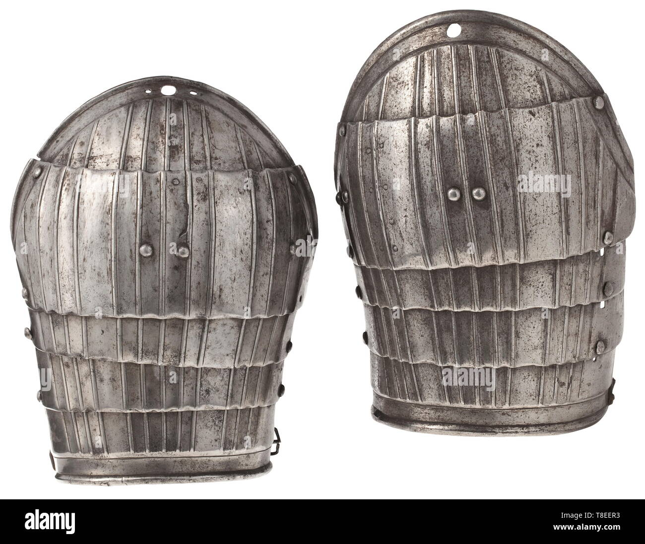 Two German fluted light spaulders for a 'Maximilian' armour with minor differences, circa 1520-25. Gutter-shaped, each of five lames embossed with a central band of four flutes flanked by two bands of three flutes and all widening slightly over the two middle lames, the upper and the lower lames with recessed borders with plain angular turned edges, and each moving on later sliding rivets and internal leathers (one lower lame replaced to match). Length 22.5cm. historic, historical, weapons, arms, weapon, arm, baronial, military, militaria, rapier, Additional-Rights-Clearance-Info-Not-Available - Stock Image