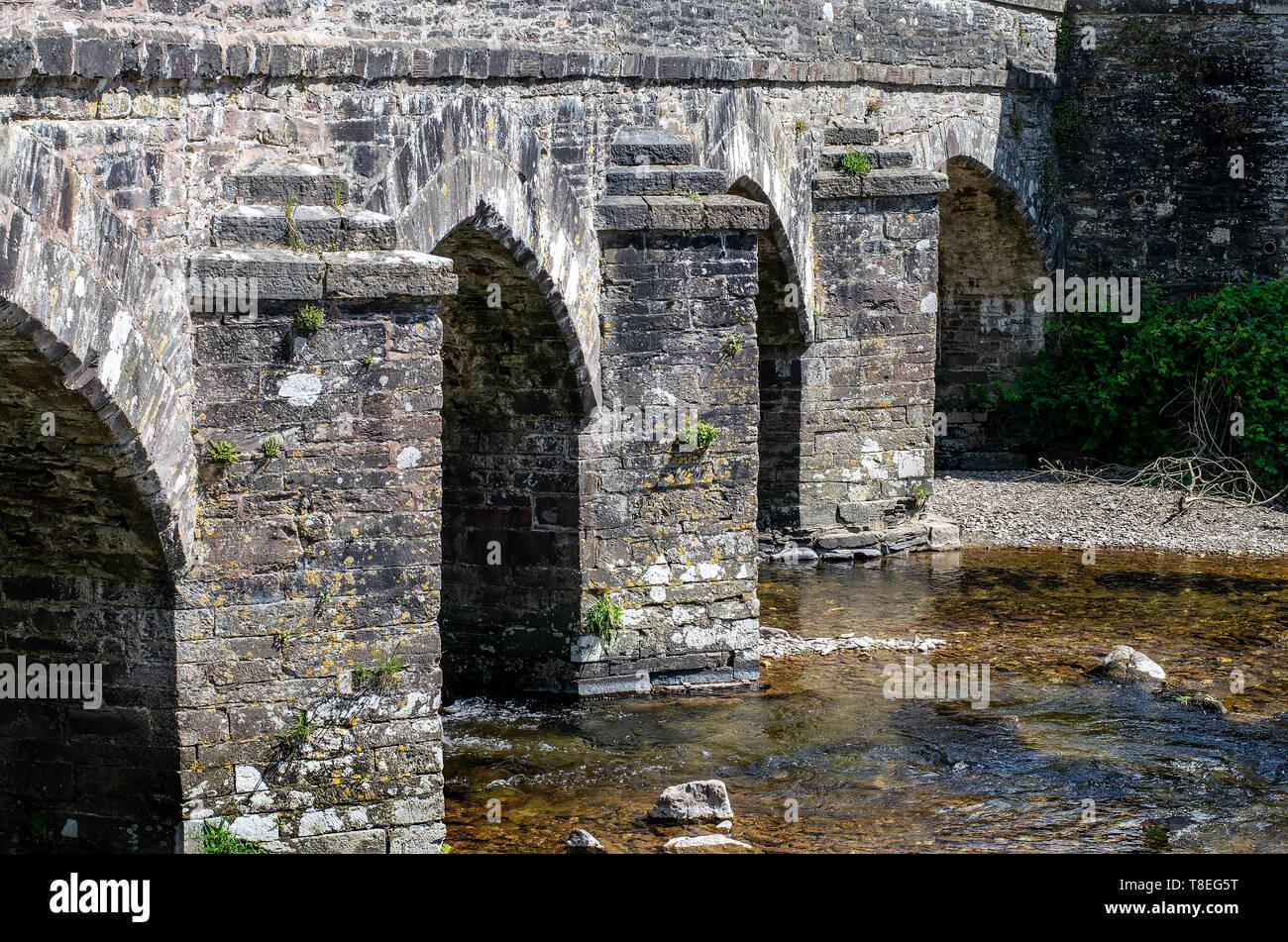 A view of the road bridge in Dulverton, Somerset, England, UK - Stock Image