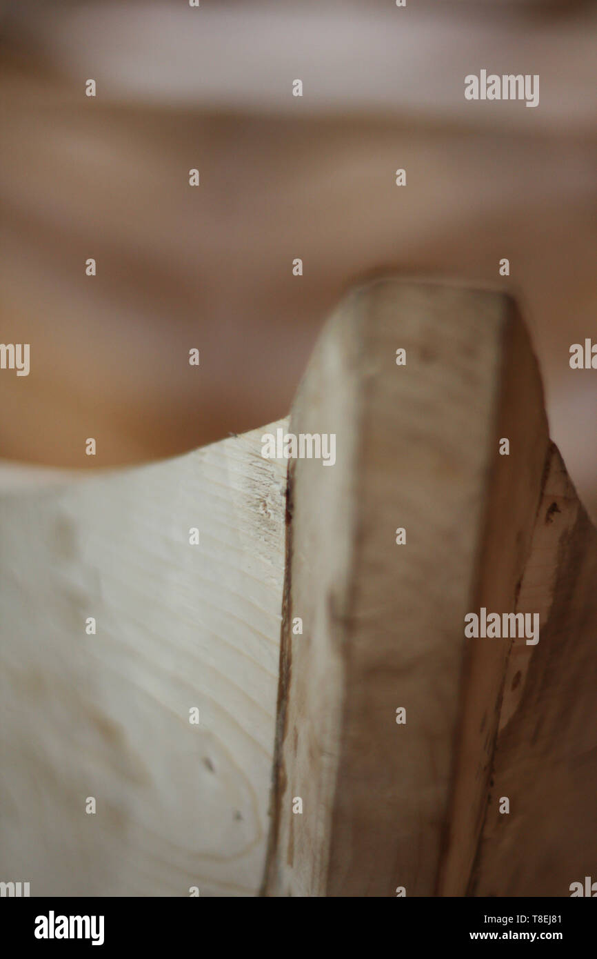 Handmade wooden boat in the barn close up view - Stock Image