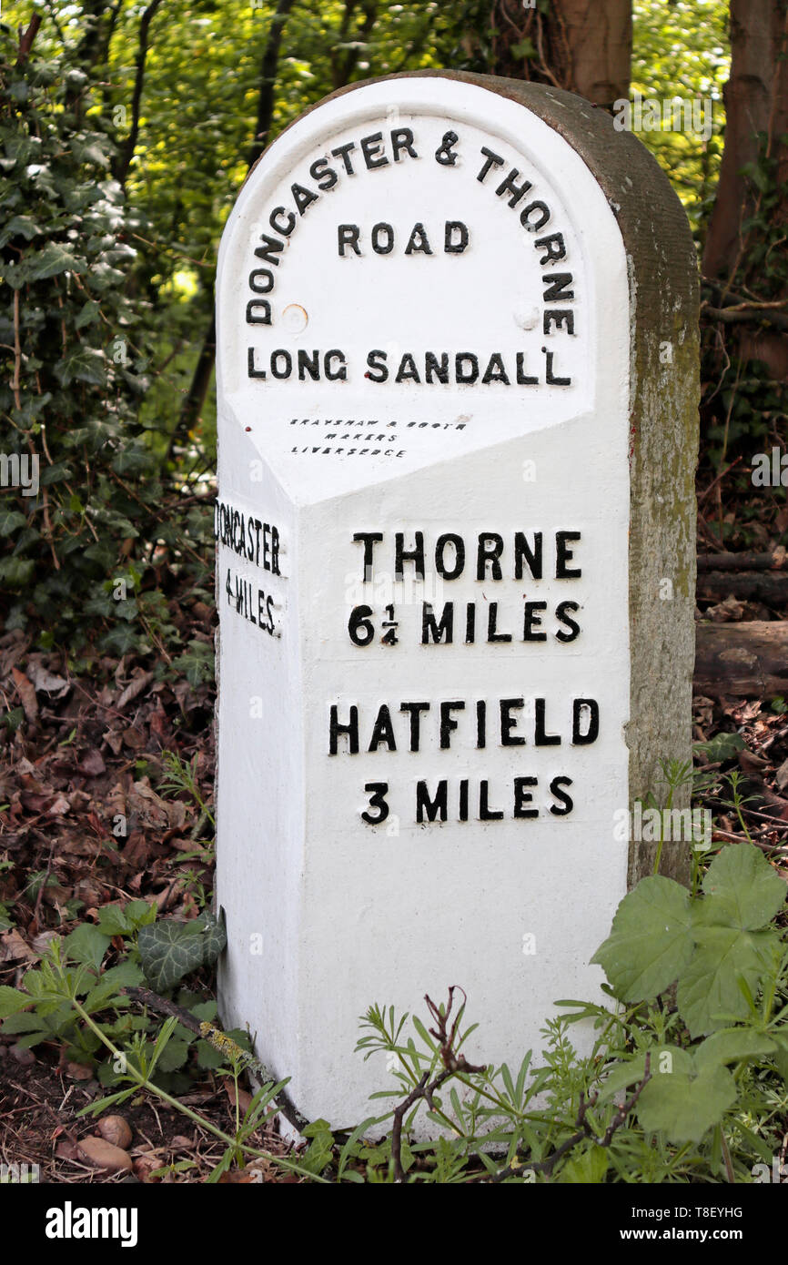 Old 19th century Milestone in Edenthorpe - Doncaster and Thorne Road - 4 miles to Doncaster - 3 miles to Hatfield - 6¼ miles to  Thorne - Stock Image