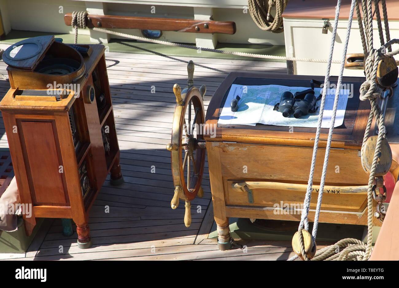 Charts at Ship's Wheel - Stock Image