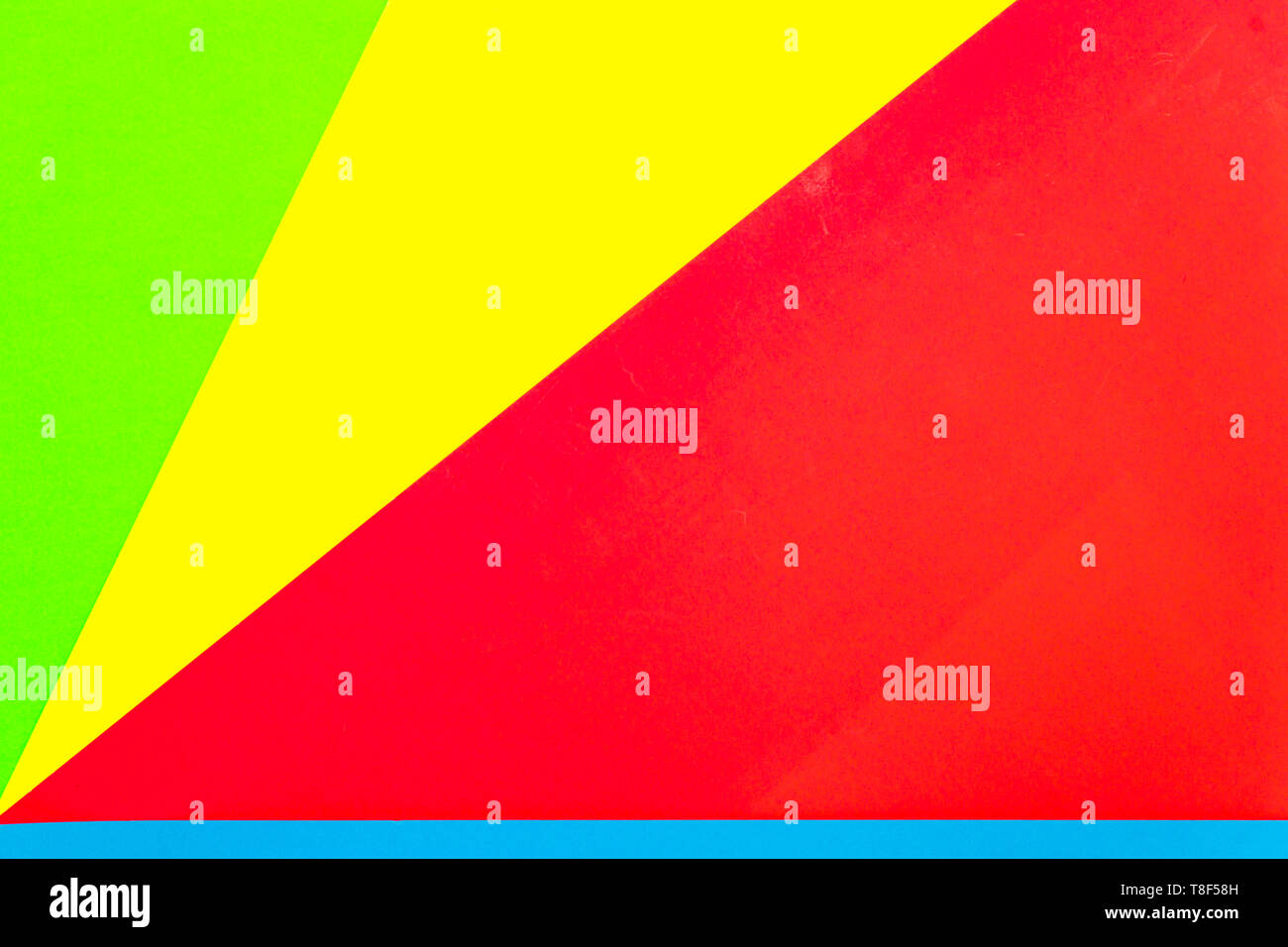 Vibrant multicolor background from cardboard of different colors. Color paper for background. Colorful abstract geometric shapes. Minimal design. - Stock Image