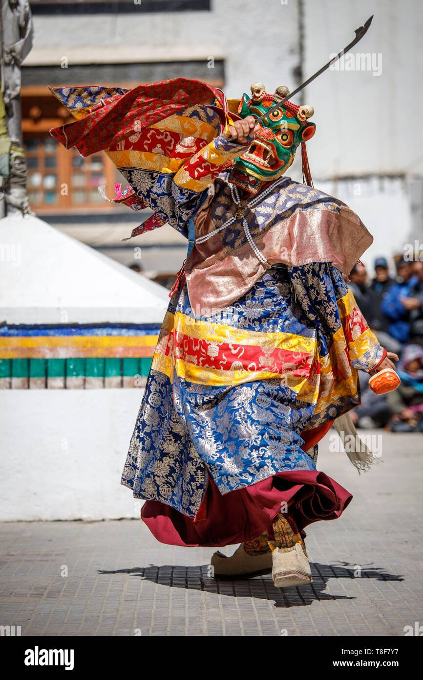 India, Jammu and Kashmir, Himalaya, Ladakh, Indus Valley, Leh, Annual Ladakh Festival, Gompa Soma Buddhist Temple (Chokhang), a monk wearing a large mask with a grimacing and frightening face showing their fangs, the Dharmapala, performs ritual dances in the temple courtyard Stock Photo