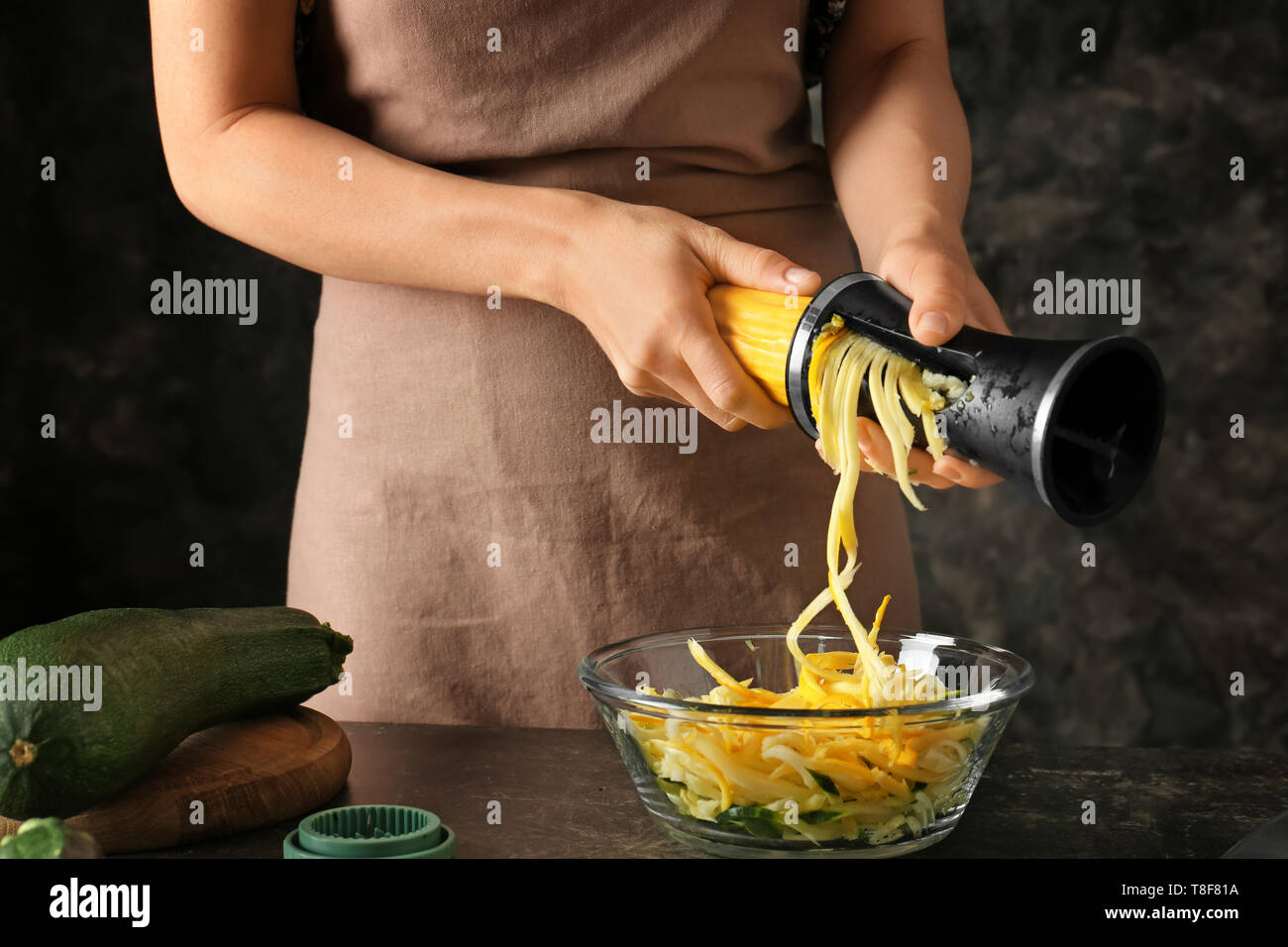 Woman making zucchini spaghetti Stock Photo