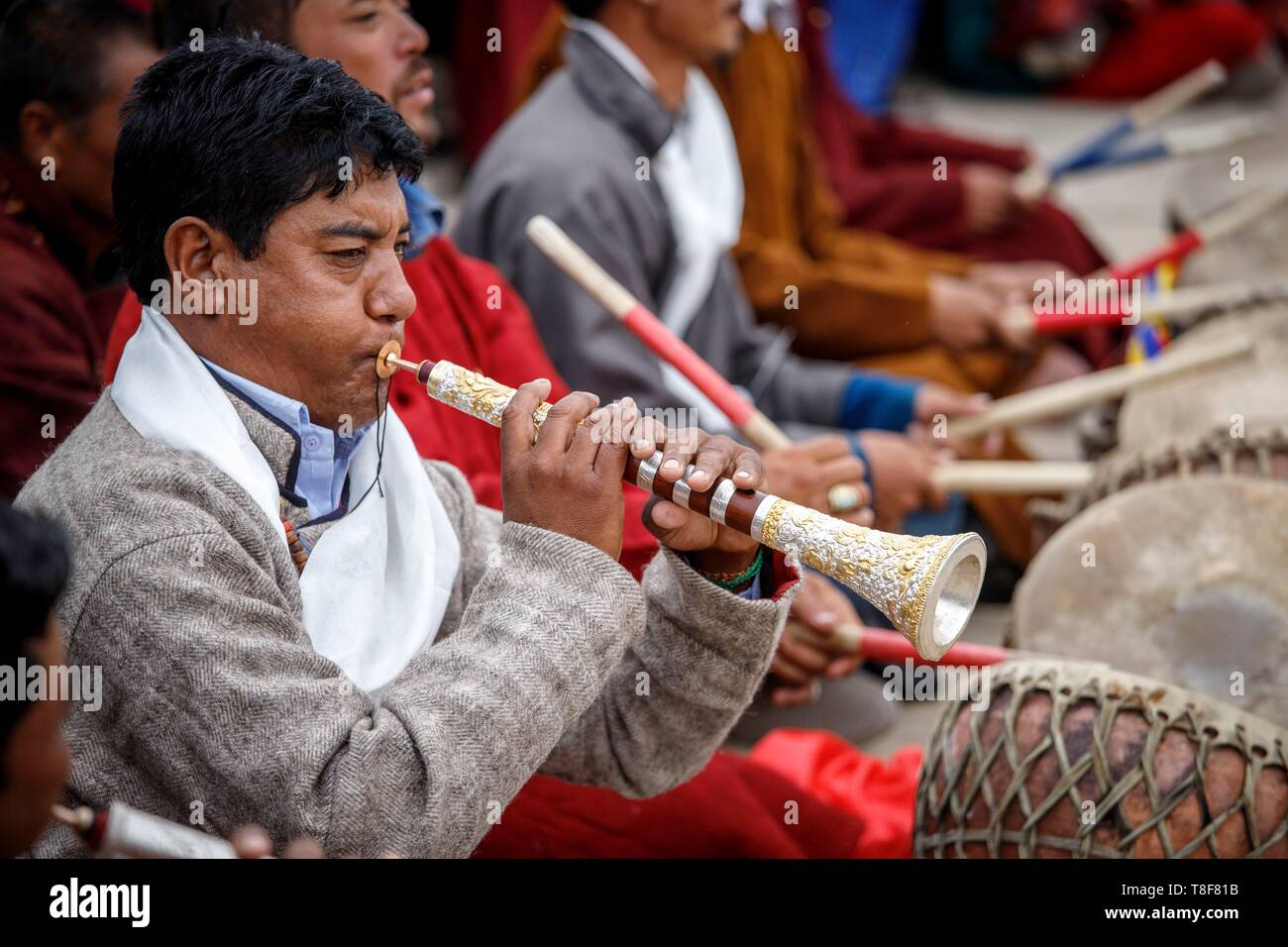 India, state of Jammu and Kashmir, Himalaya, Ladakh, Indus Valley, Leh, annual Ladakh Festival, to accompany the dancers a musician plays his gyalings, an oboe circled with copper and silver - Stock Image