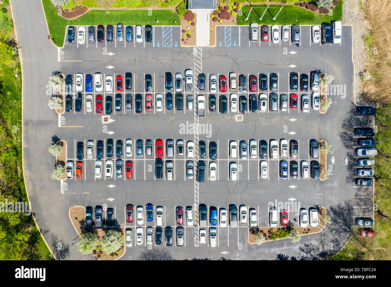 Aerial drone view of a busy corporate parking lot - Stock Image