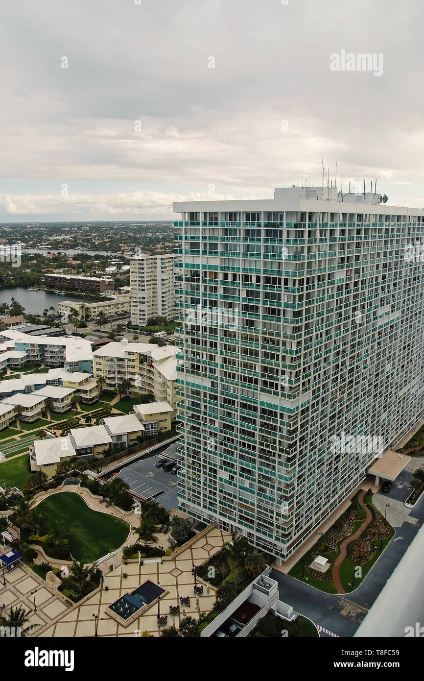 Residential buildings and neighborhood on cloudy sky background in Fort Lauderdale, USA. Cityscape, aerial view. House building and city construction concept. Summer vacation and travelling. - Stock Image