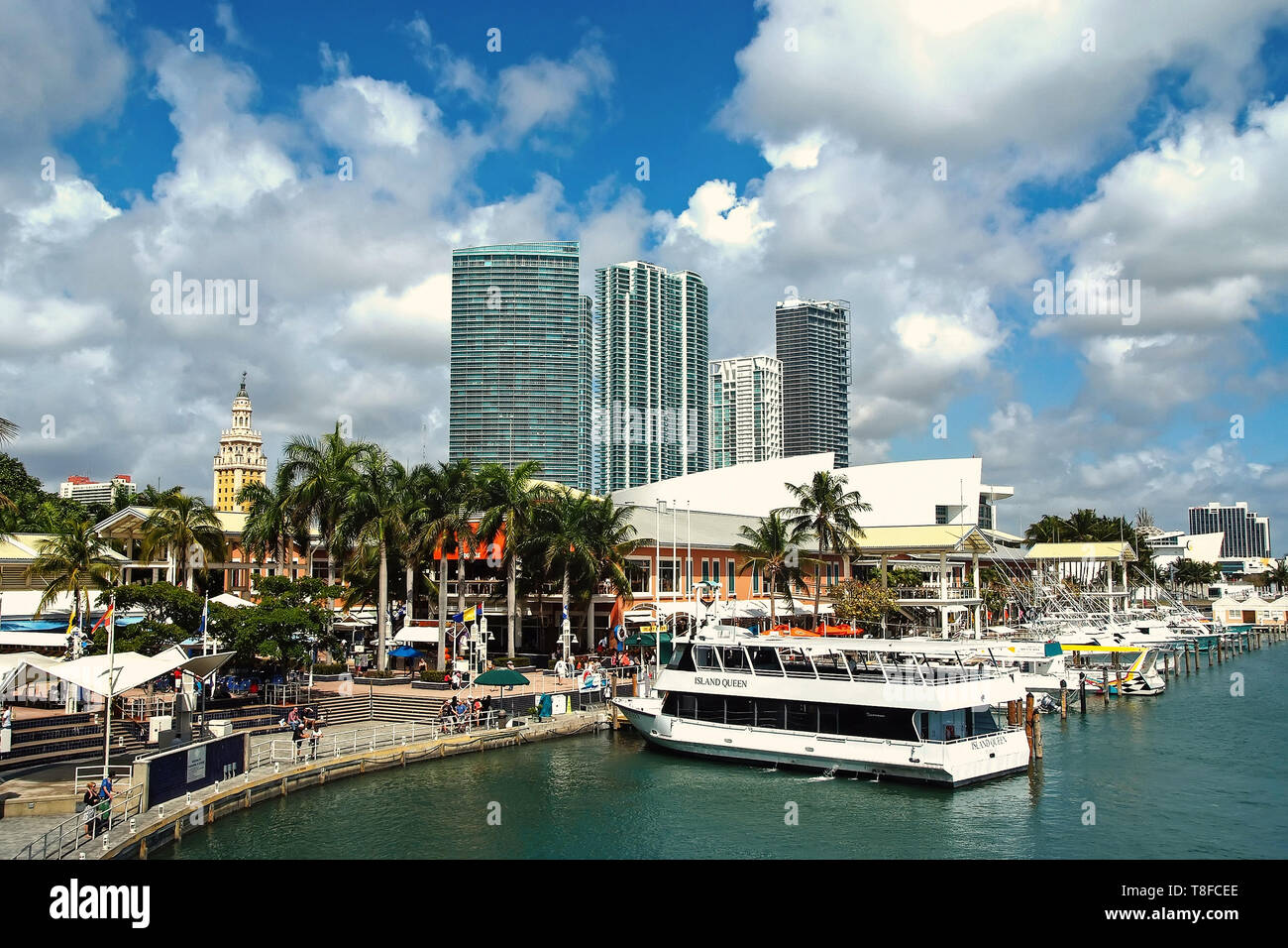 Miami, USA -september 28, 2008 : city buildings and boats on blue water in harbor waterfront on cloudy sky background in miami, USA. Summer vacation and travelling concept - Stock Image