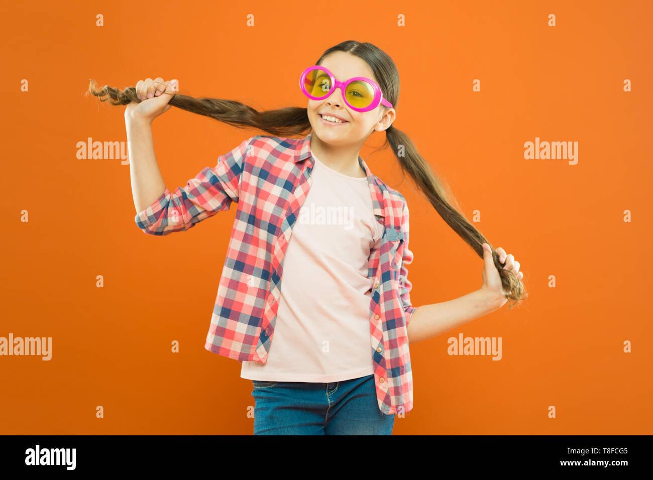 Girl wear eyeglasses. Ultraviolet protection crucial while polarization more preference. Optics and eyesight. Child happy good eyesight. Summer accessory. Eyesight and eye health. Improve eyesight. - Stock Image