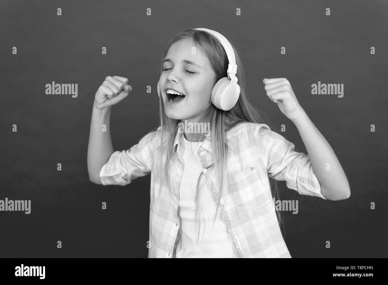 Little girl listen song headphones  Online radio station