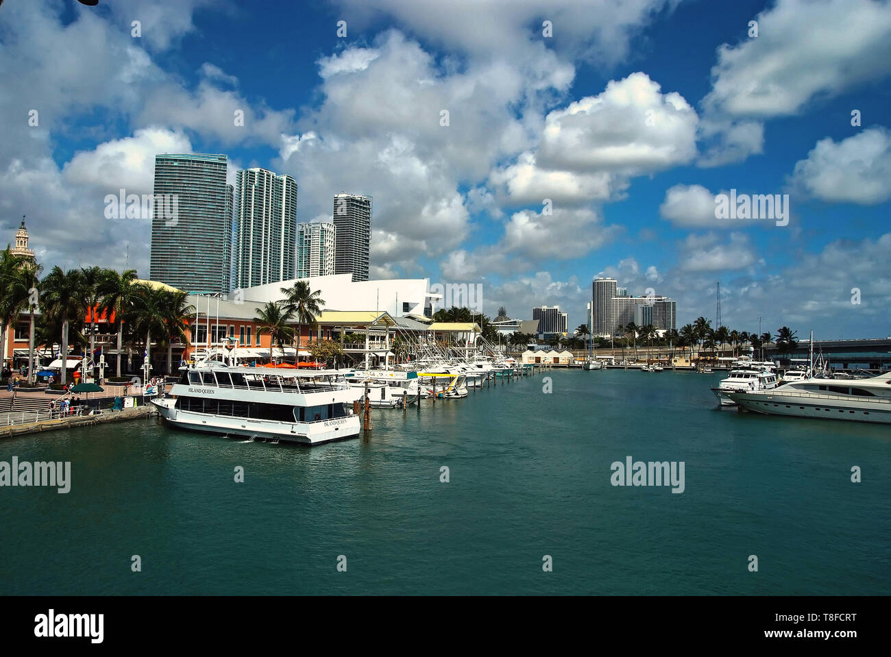 Miami, USA -september 28, 2008 : city harbor waterfront with boats on blue water on cloudy sky background Miami, USA. Summer vacation and travelling concept - Stock Image