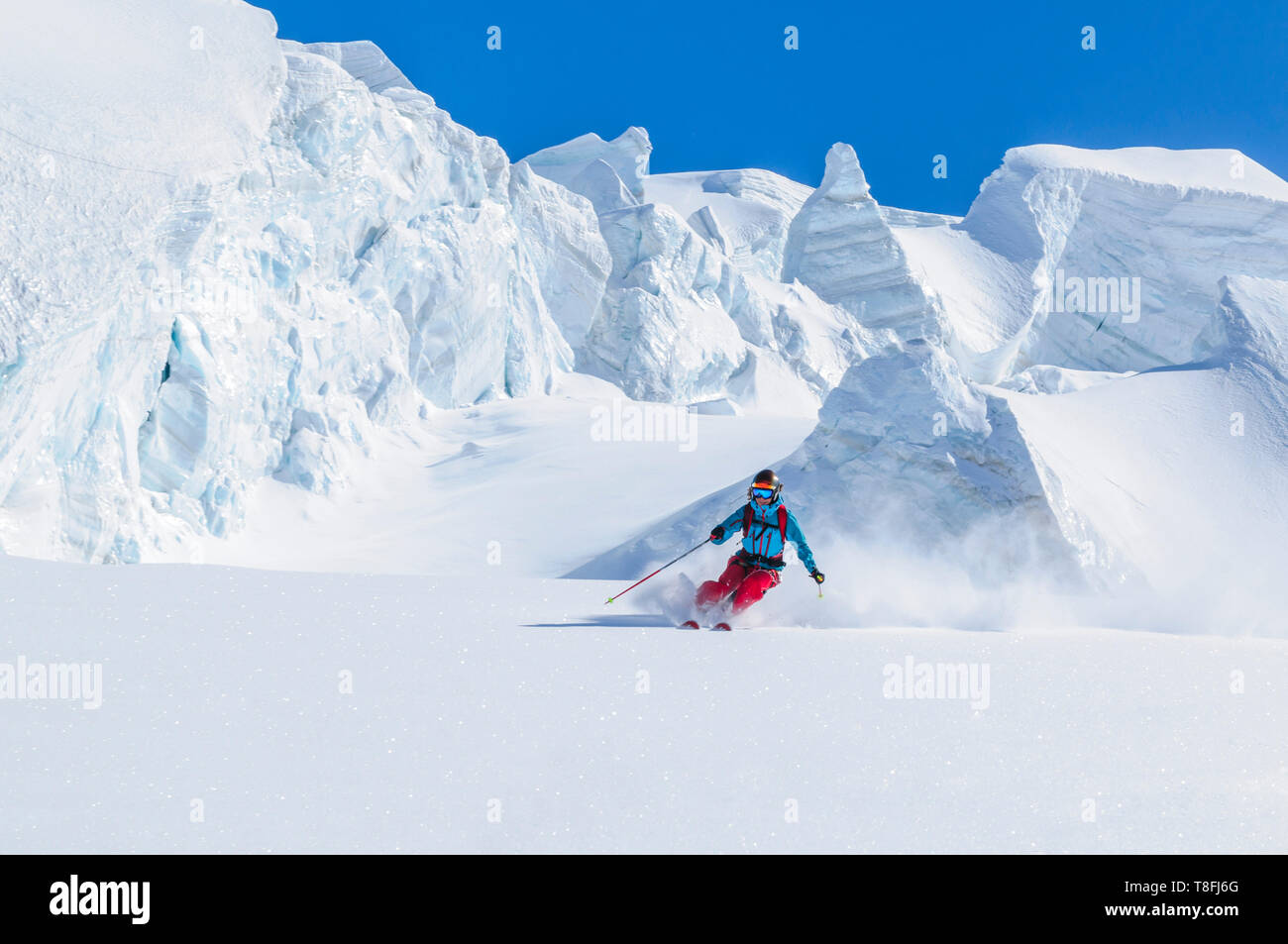 Female freeskier skiing in backcountry on fantastic Monte Rosa glaciers Stock Photo