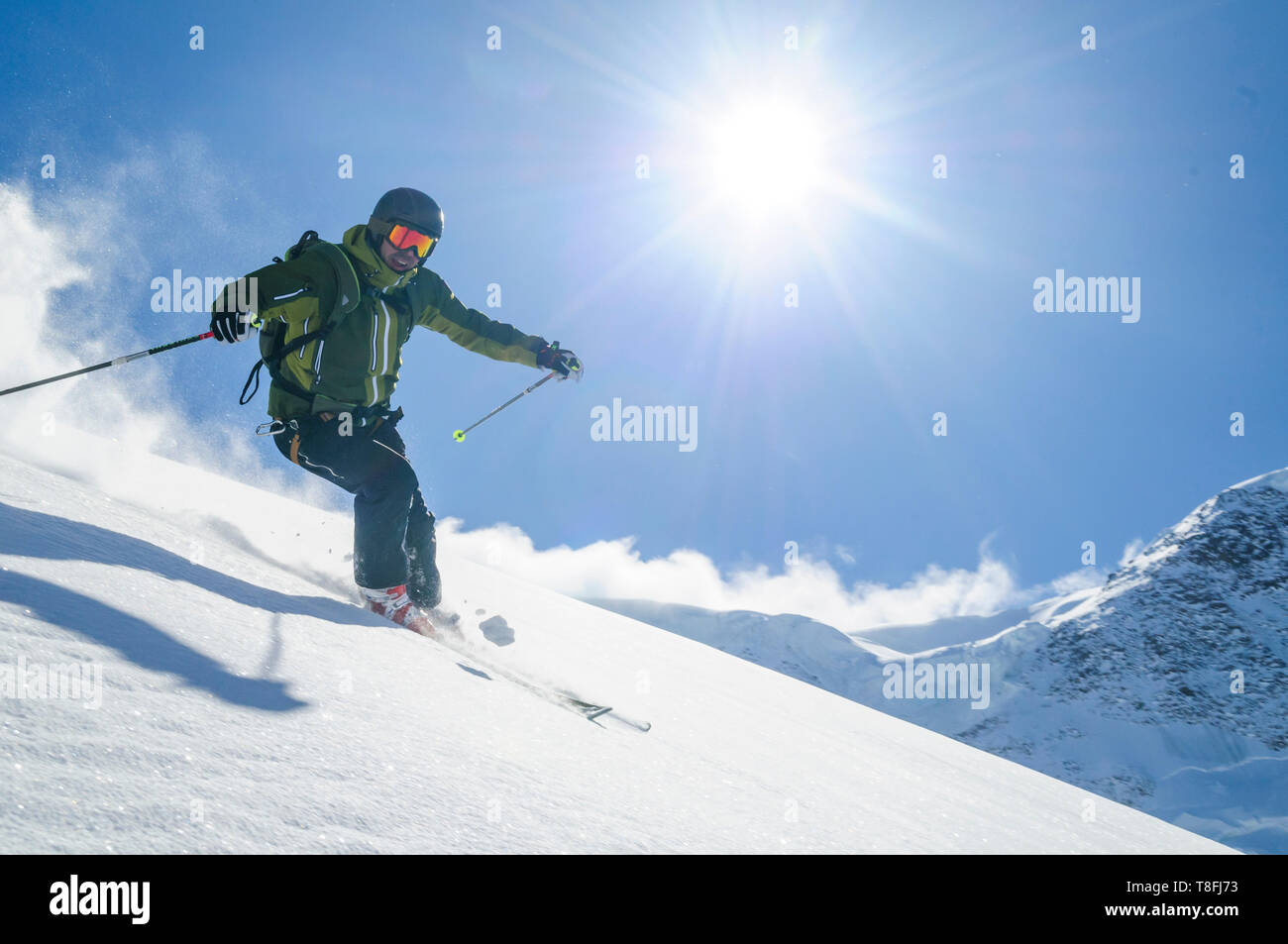 Expert skier on Monte Rosa glaciers in impressive high alpine nature Stock Photo