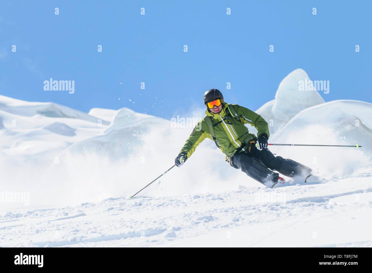 Expert skier on Monte Rosa glaciers in impressive high alpine nature Stock Photo